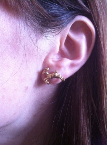 Emma's ear with Jeremy Hoyle gold plated silver deer earrings