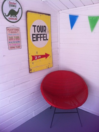 spray painted bucket chair in summerhouse